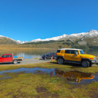 4WD tour at edge of high country lake
