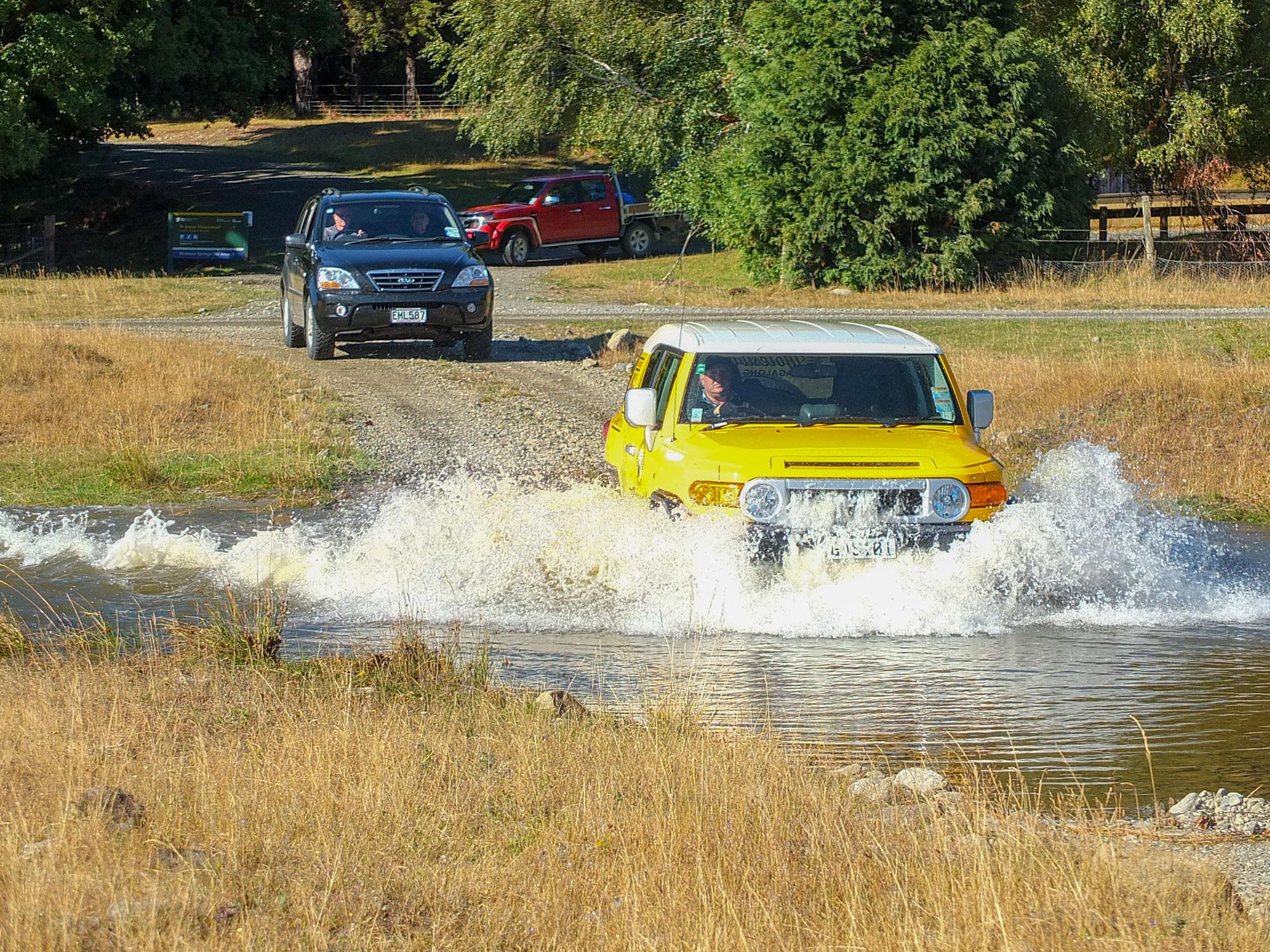 4WD tour fording a river