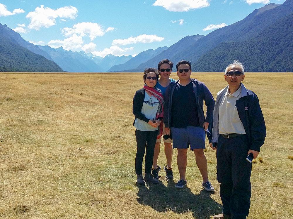 Family group photo South Island scenery on custom tour