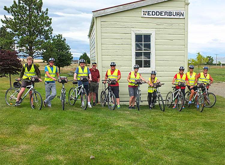 Group of Otago Rail Trail cyclist outside the former Wedderburn railway station